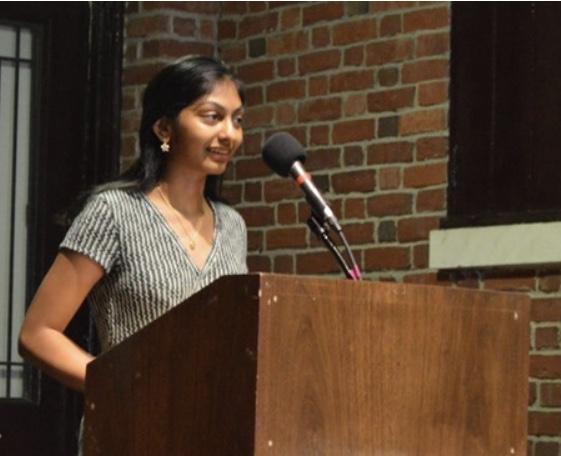 Meghana+Maddali++giving+a+speech+at+the+event